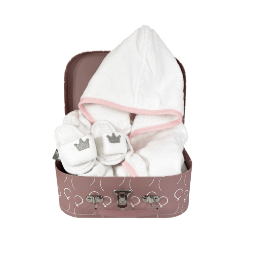 Pink suitcase with personalised white bathrobe and white hotel slippers