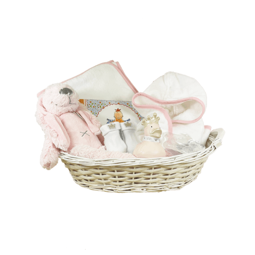 White basket with bathrobe and hooded towel white with pink piping, pink rubber duck, socks and book pauline old baby's first year
