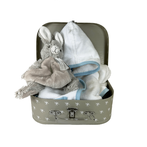 Grey suitcase with white stars, white bathrobe with blue piping and cuddle toy rabbit rio (happy horse)
