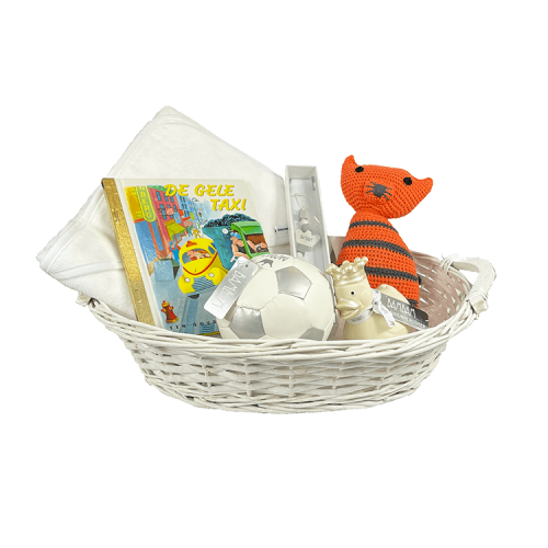 White basket with bath cape, theo tiger cuddly toy, golden book, pacifier clip, ball and rubber duck in ivory