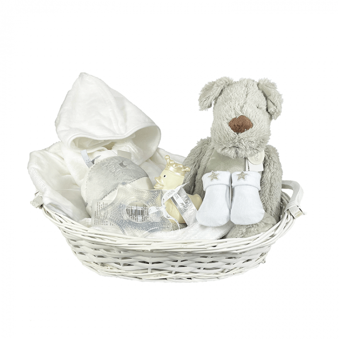 White basket with white bathrobe, gray stuffed toy Dog Dean (Happy Horse) and ball with rattle, socks and teehter (bamBam)