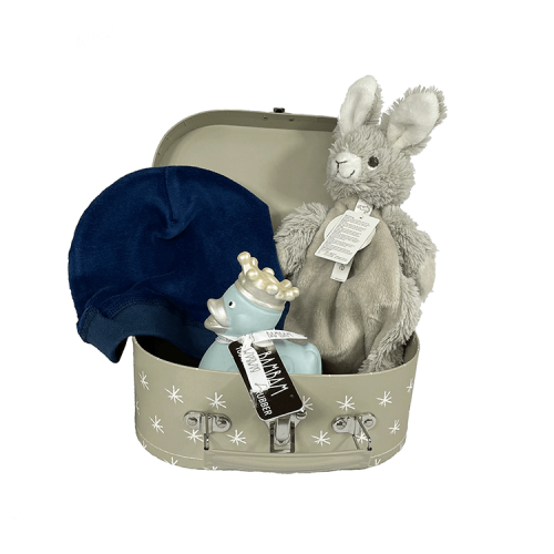 Small grey suitcase with white stars containing tuttle rabbit rio from happy horse, a dark blue velvet hat from snoozebaby and a blue rubber duck made