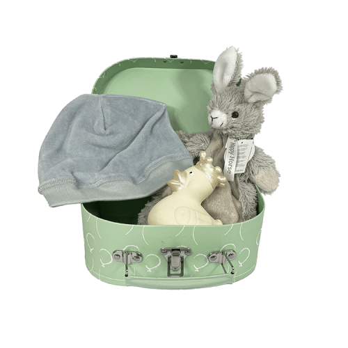 Small mint green suitcase with white balloons containing tuttle rabbit rio from happy horse, a gray velvet hat from snoozebaby and an ivory-colored rubber duck