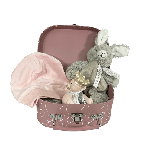Small pink suitcase with white balloons containing tuttle rabbit rio from happy horse, a pink velvet hat from snoozebaby and a pink rubber duck