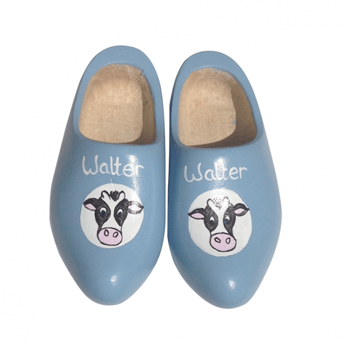 Hand-painted wooden shoes, blue with a cow's head on it