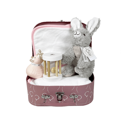 Pink suitcase with white balloons, containing a bath cape with pink trim with name, a pink rubber duck and a wooden rattle from bamboo and the cuddly Rabbit Rio from Happy Horse